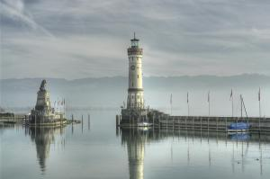 The Journey poem by Michelle Sherlock Photo of harbour complete with lighthouse and small blue boat