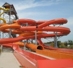 Photo of orange helter skelter slide with tubes turning and swirling round