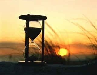 DWINDLING - HOURGLASS AT SUNRISE